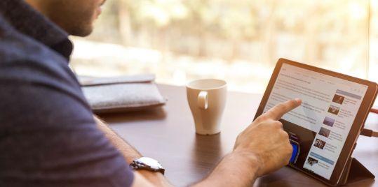 A man using an iPad