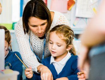 A teacher with school children