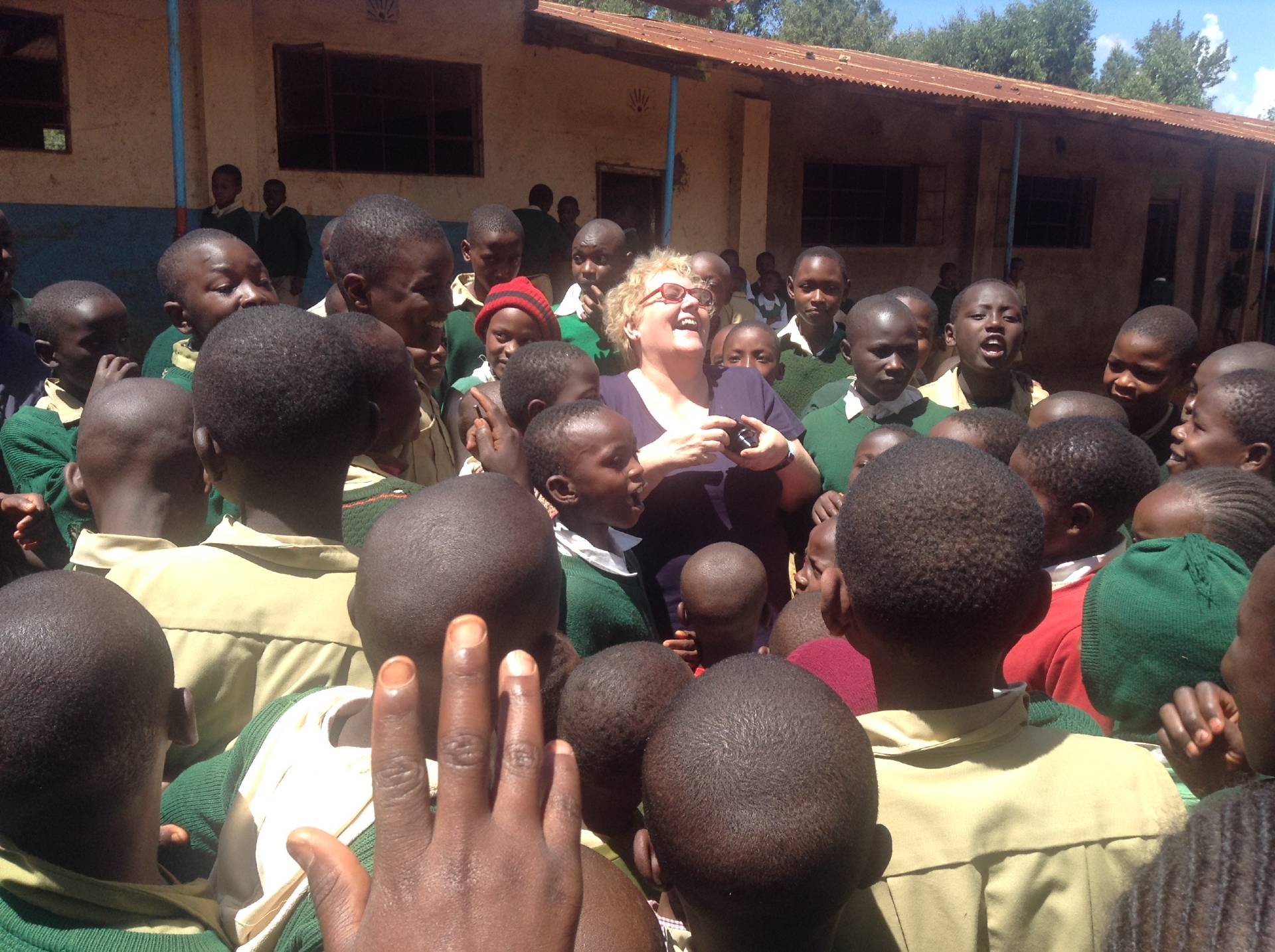 Pamela Draycott surrounded by Kenyan children