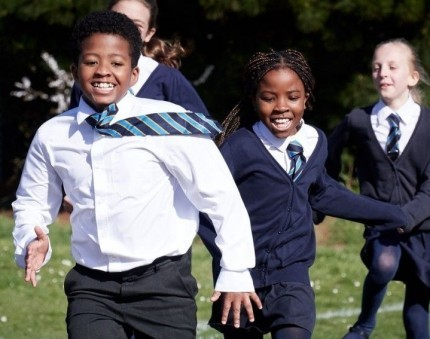 Children running on a playing field