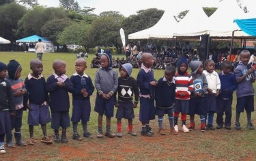 A group of young Kenyan school children with their teachers