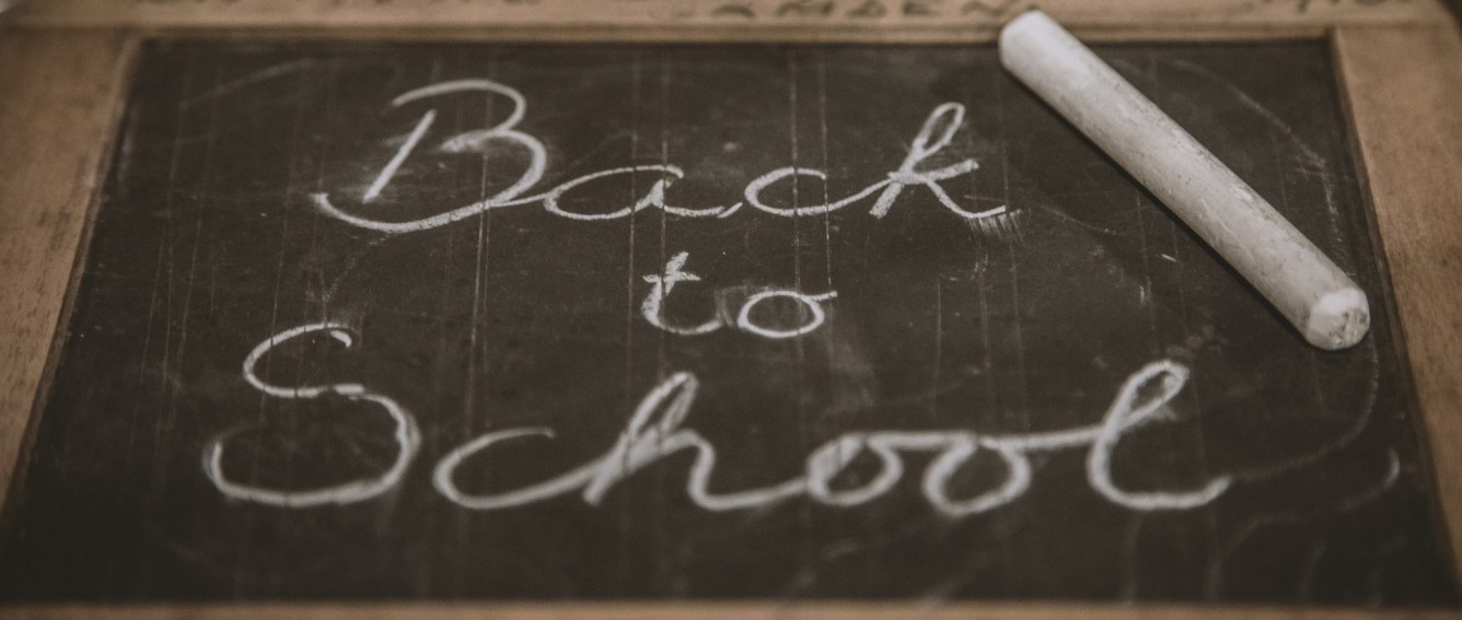 Back to school written on a chalk board